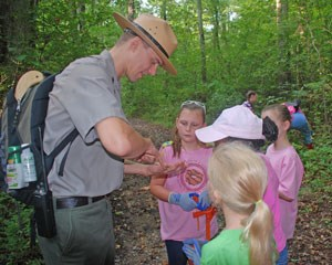 A park ranger works with young people at Chickamauga Battlefield