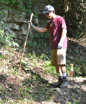 A volunteers helps clear a trail on Lookout Mountain
