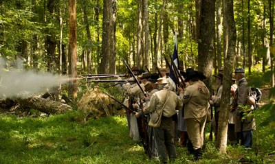 Confederate living historians fire in the woods of Chickamauga Battlefield