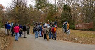 Visitors gather for a ranger-guided tour of Sherman Reservation