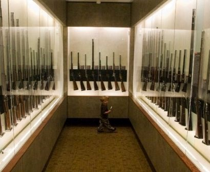 A young visitor explores the Fuller Gun Collection