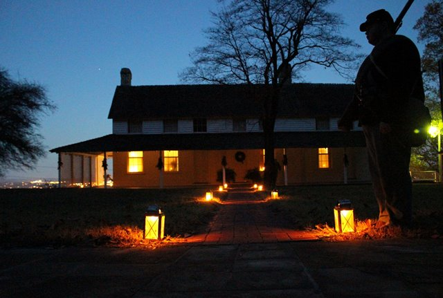 cravens house illuminated by christmas lights a silhouetted civil war soldier stands in the foreground - When Does Christmas In The Park Open