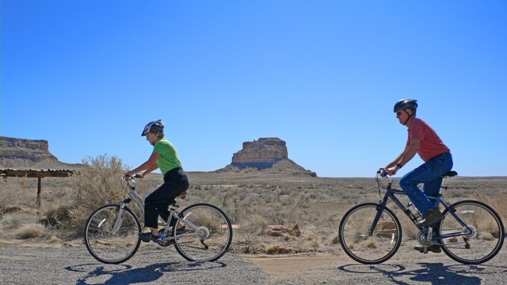 Bicyclists in front of Fajada Butte