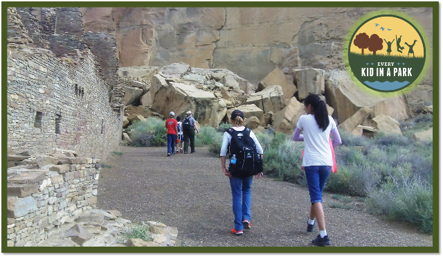 Kids enjoy hiking with a Park Ranger along ancient buildings at Chaco Culture National Historical Park
