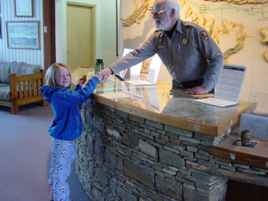 Prairie Bergman gets her Jr. Ranger badge