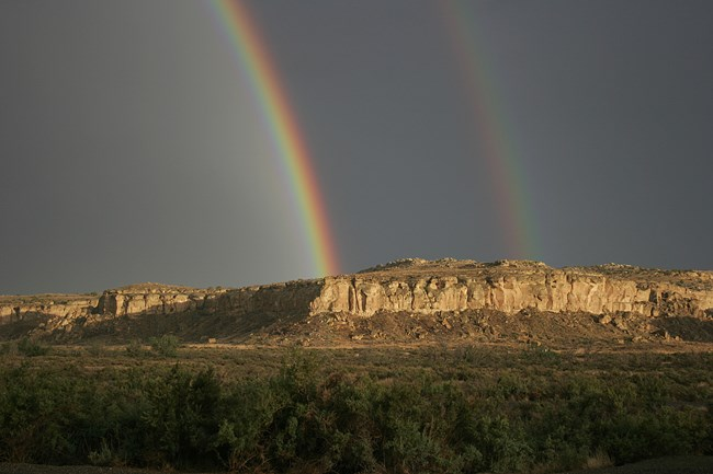photo of rainbow over canyon