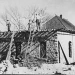 Men working on an old stone building