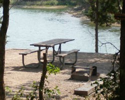 Empty campsite with picnic table and fire ring