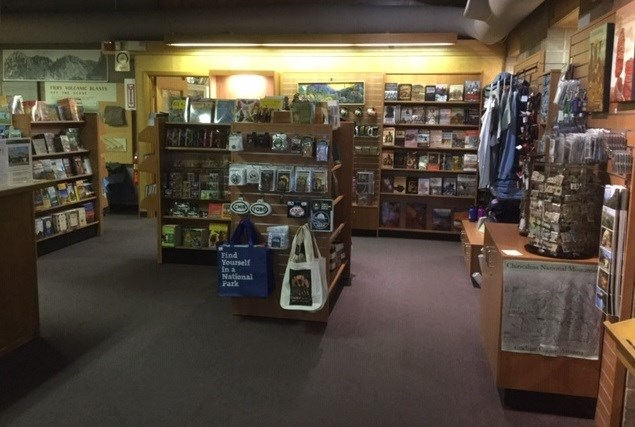 Bookstore with books, tote bags, and other souvenirs on shelves.