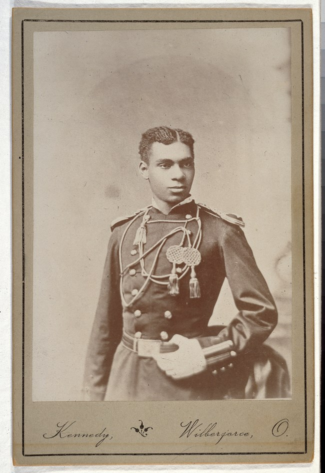 Young African American soldier in military dress uniform.
