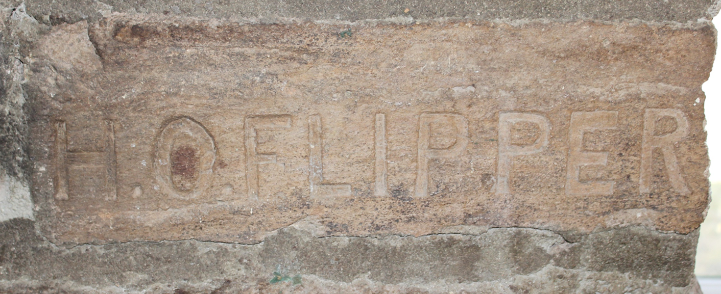 Stone carved with H. O. Flipper