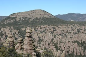 Sugarloaf Mountain rises behind a forest of rock spires.