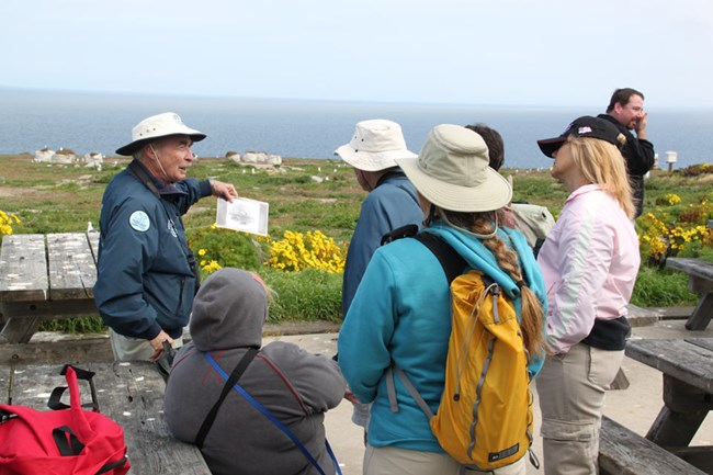 Park volunteer leading hike for visitors.