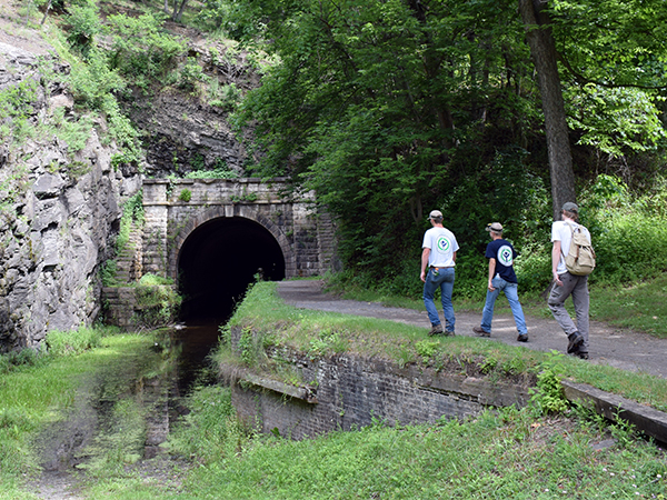 YCC students walk into Paw Paw tunnel.