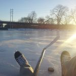 View of Hockey player's feet laying on ice at Cushwa Basin.