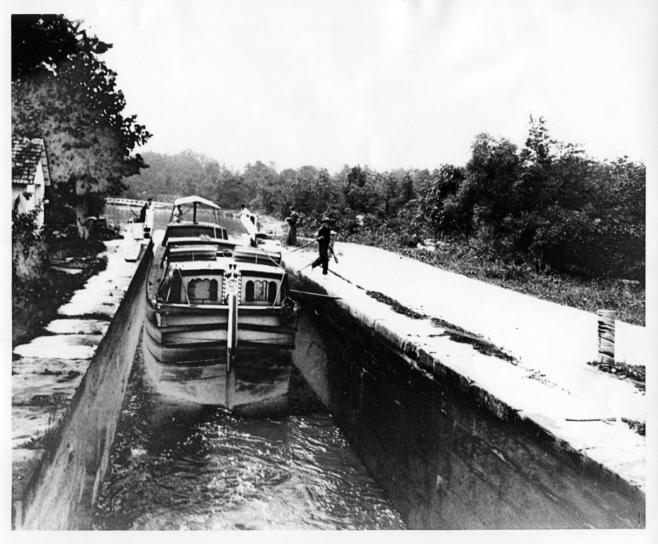 boat being guided into lock