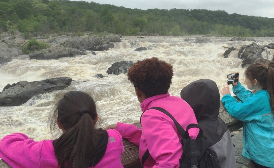 Students watching Great Falls from the overlook