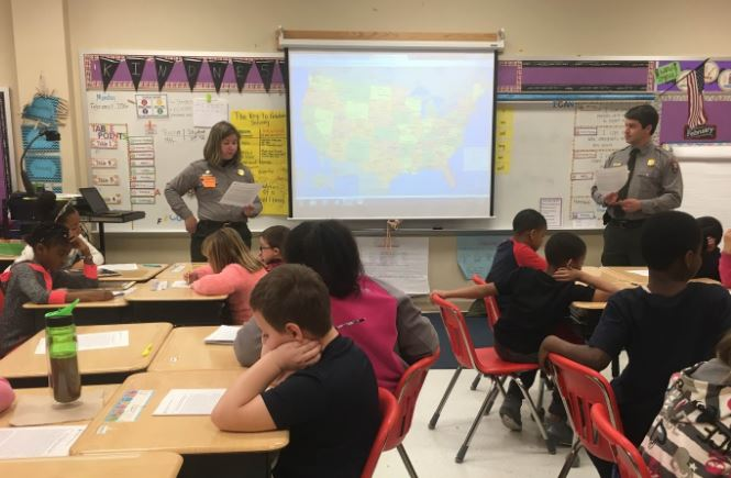 Two Park Rangers visit a classroom