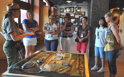 A Park Ranger shows Teachers a lock model at the Cumberland Visitor Center museum