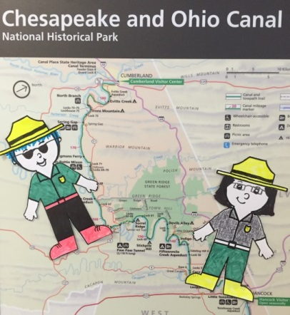 Two paper flat rangers on a map of the canal
