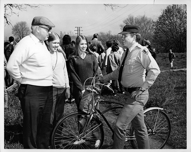 Visitors talking to a Park Ranger (1972)