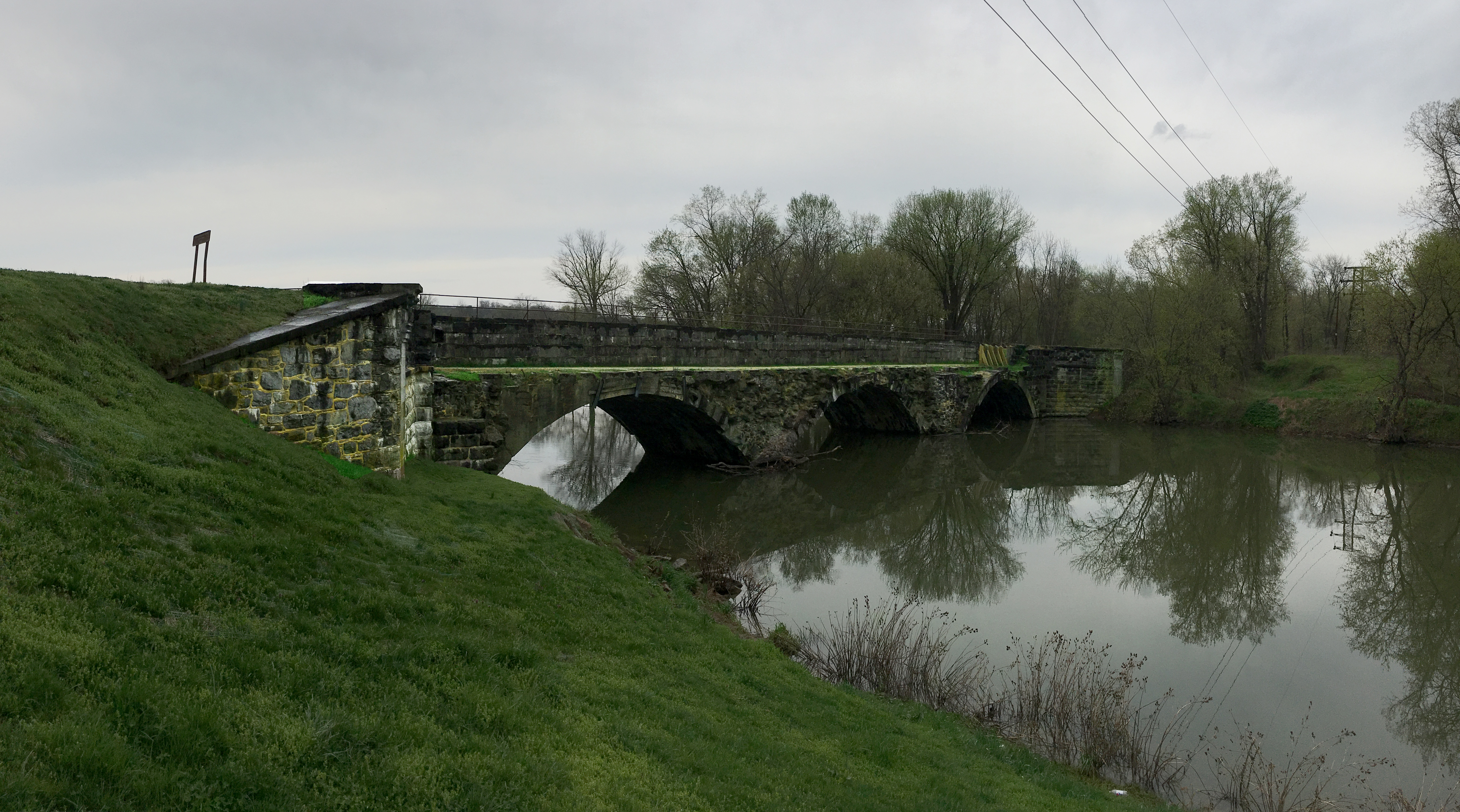 The Conococheague Aqueduct before restoration on a cloudy day.