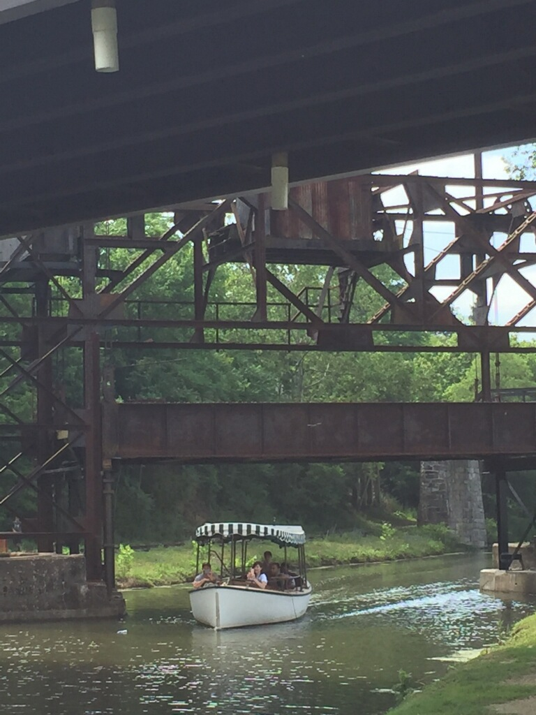 Launch Boat drives under the railroad lift bridge for the first time in 93 years.