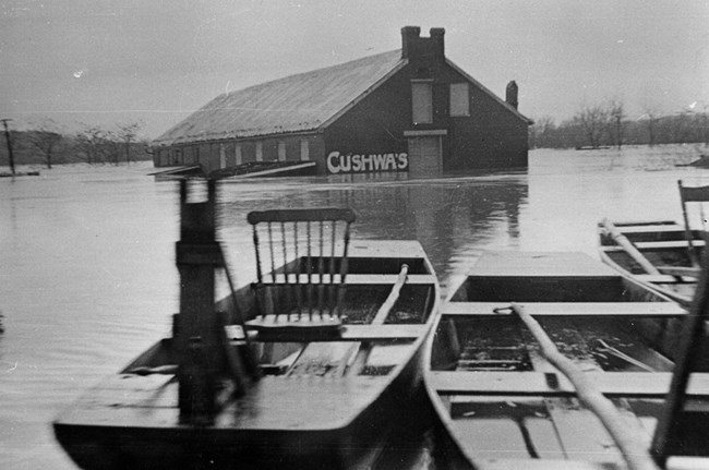 A boat floats in front of the Cushwa Warehouse in 1936