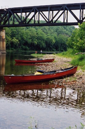 Photo of canoes beached along the canal.
