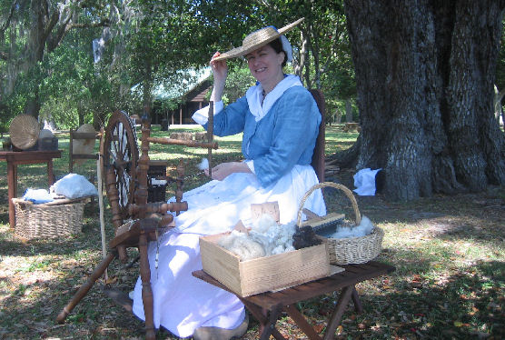 Suzanne Collins of the Carolina Ladies Aide Society spins thread in period costume during Colonial Days 2008.