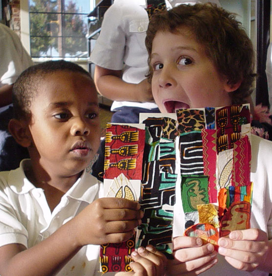 Two children hold bookmarks they created.