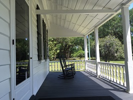 Front porch of house and rocking chairs