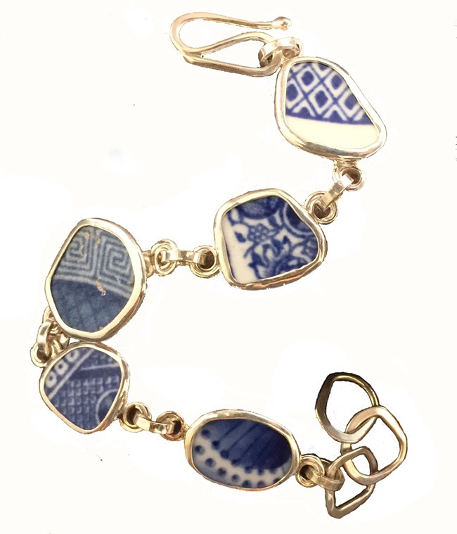 photograph of a bracelet made of pieces of blue and white changey