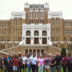 Educator's Institute participants standing with a ranger in front of Little Rock Central High School National Historic Site
