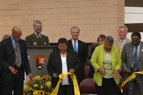 Several of the Little Rock Nine cut the ribbon to officially dedication the park's new visitor center.