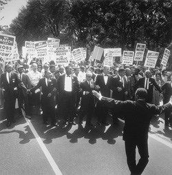 1963 March on Washington. Civil Rights leaders begin the march with fellow marchers holding signs urging an end to segregation and increased job opportunities.
