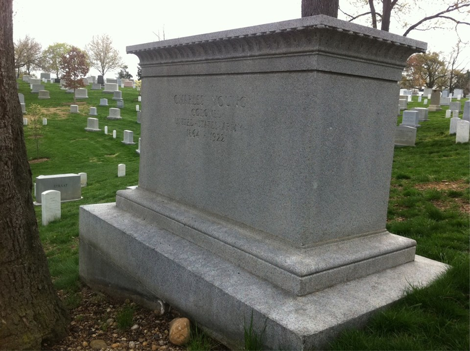 "A large stone tomb with ""Charles Young"" written on the middle of it"