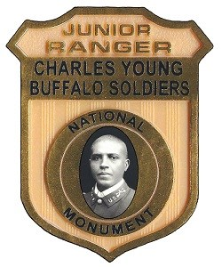 Jr Ranger Badge with portrait of Charles Young in the middle.