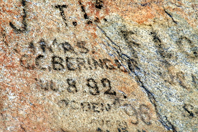 Historic emigrant signatures done in axle grease on granite.