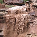 Flash flood pouring off cliff face