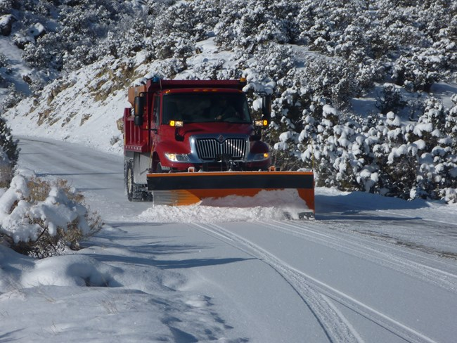Snow plow clearing Rim Rock Drive