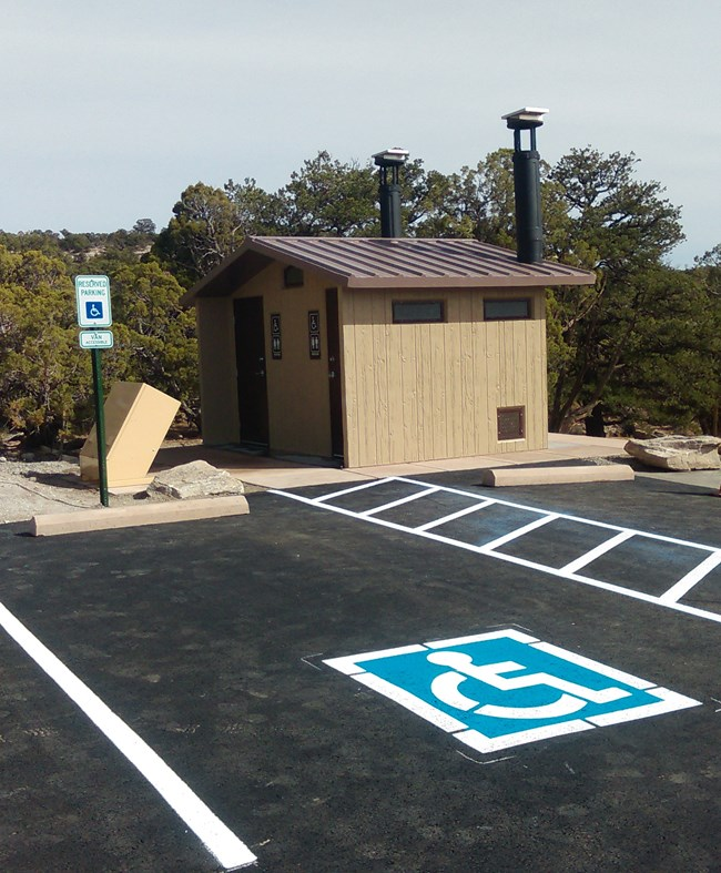Vault Toilet at Upper Liberty Cap Trailhead with paved accessible parking.
