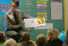 Park Ranger works with children in classroom.