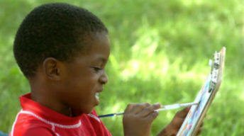 Child paints in a park