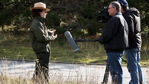 Park ranger talking to news reporter