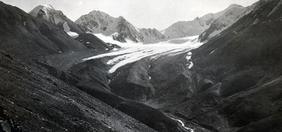 a historic picture of a glacier filled valley