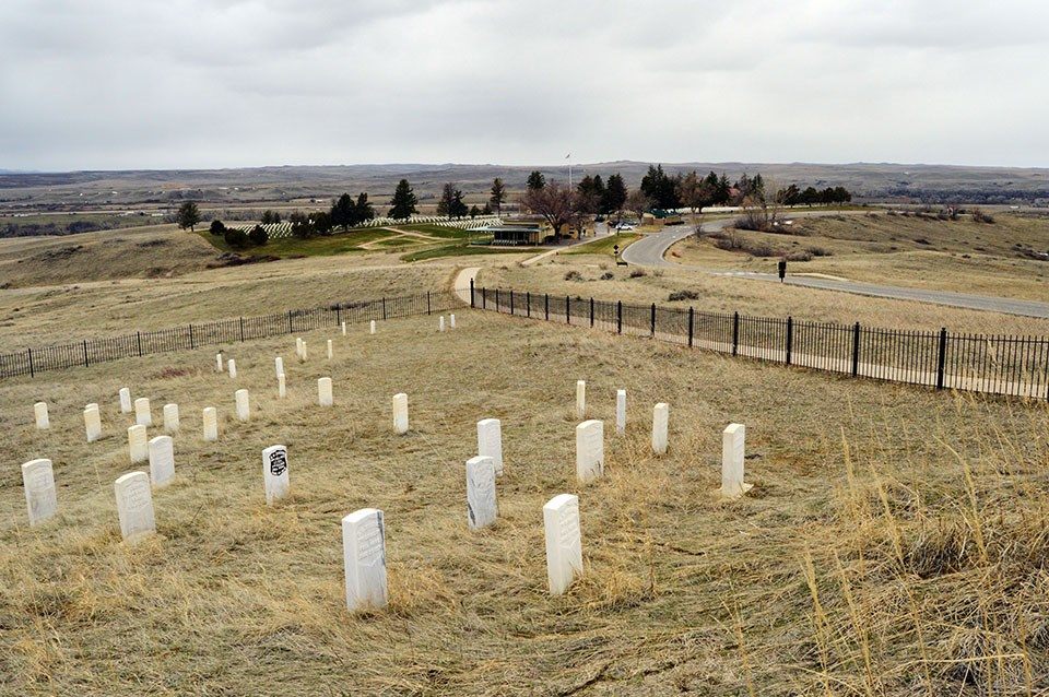 Looking down at Custer's marker. Can see the Visitor Center in the background.