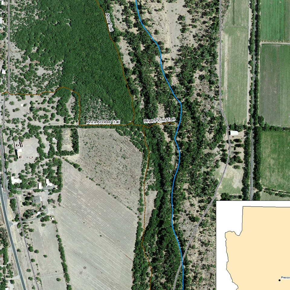 color satellite image of mission grounds and forested river environment to the east