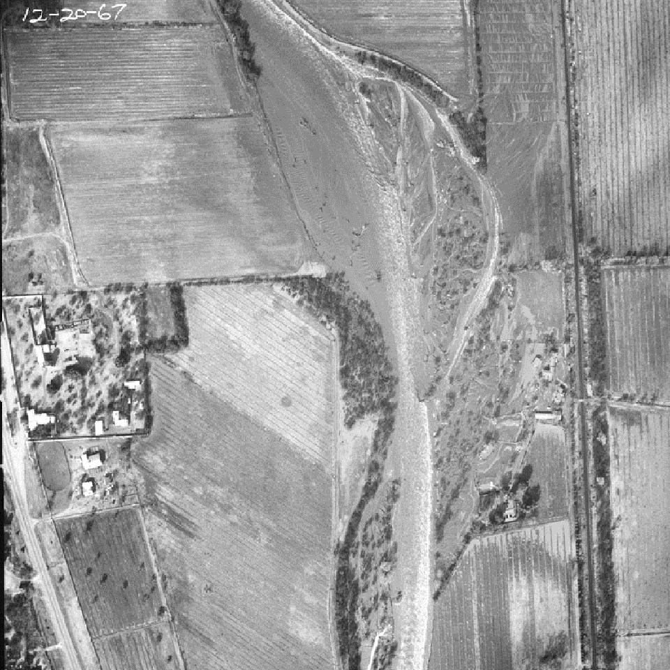 black and white aerial photo of mission grounds and farm fields to the east