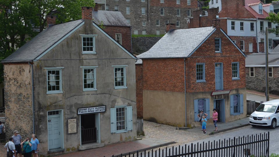 full color photo of same two buildings in present day, restored as museums and exhibits